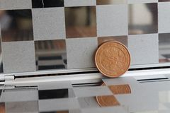 Euro coin with a denomination of 5 euro cents in mirror reflect wallet, chequered background - back side Stock Images