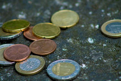 Euro coins. Mixed Euro coins on the ground stock photos