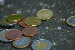 Euro coins. Mixed Euro coins on the ground stock images