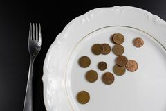 Euro coins money eating concept. Nothing to eat. Eating money an Stock Photos