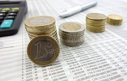 Euro coins. On newspaper and pen macro Stock Photography