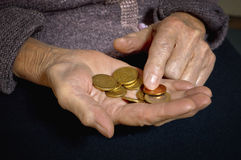 Euro coins in old womans hands. Stock Photo