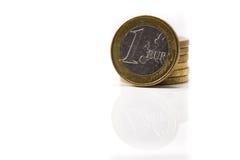 Euro coins. One euro coin among other coins stock photos