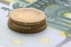 Euro coins on one hundred euro banknote. Close up of pile of euro coins on one hundred euro banknote Stock Photo