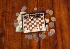 Euro coins over chessboard Stock Image