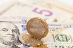 Euro coins over dollar notes Royalty Free Stock Photography