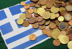 Euro coins over Flag of Greece Royalty Free Stock Image