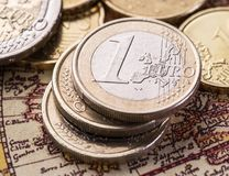 Euro coins over the old world map. Stock Photography