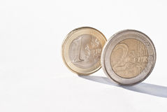 Euro coins over white. One and two euro coin, on the white background.selective focus royalty free stock photography