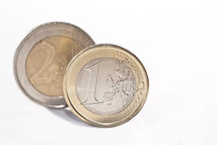 Euro coins over white. One and two euro coin, on the white background.selective focus royalty free stock photos