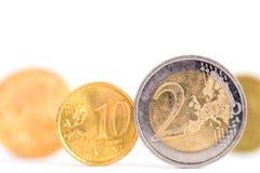 Euro coins over a white background Royalty Free Stock Photos
