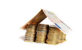 Euro Coins pile House with banknote roof Royalty Free Stock Photos