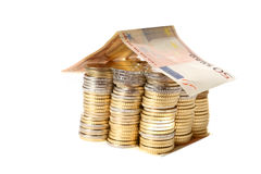 Euro Coins pile House with banknote roof Stock Photo