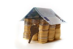Euro Coins pile House with banknote roof and key Royalty Free Stock Images