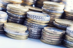 Euro coins on pile of other coins in background Royalty Free Stock Images