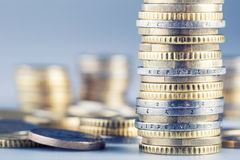Euro coins on pile of other coins in background Stock Photo