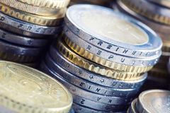 Euro coins on pile of other coins in background Royalty Free Stock Photo