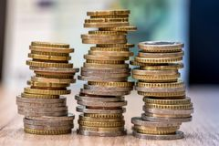 Euro coins in a pile at table. Close up royalty free stock photo