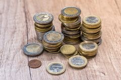 euro coins in a pile at table. Stock Photos