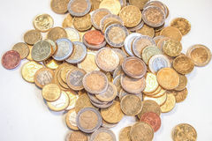 Euro coins. A pile of euro coins, on a white table Royalty Free Stock Image