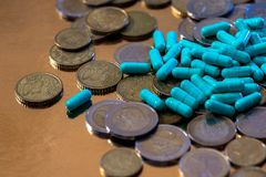 Euro coins and pills. In capsules stock photo