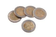 Euro coins on a plain white background. Royalty Free Stock Photo