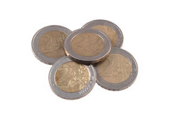 Euro coins on a plain white background. Royalty Free Stock Photography