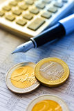 Euro coins and pocket calculator Royalty Free Stock Images