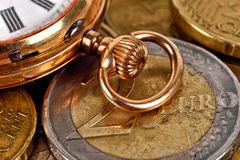 Euro coins and pocket watch Stock Image