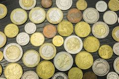 Euro coins and Polish Zloty on a wooden table. Euro coins and Polish Zloty on a wooden table as a background Royalty Free Stock Photos