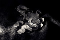Euro coins in the pouch. On the black fabric Stock Photo