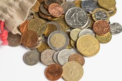 Euro coins pour out of the bag royalty free stock image