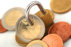 Euro coins protected with padlock Royalty Free Stock Image