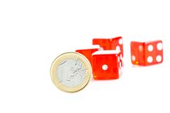 Euro coins and red dice Royalty Free Stock Photography