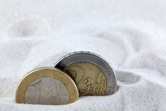 Euro coins in sand. Royalty Free Stock Image