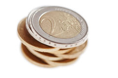 Euro coins stacked. A pile of euro coins isolated on white Stock Photo