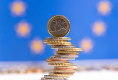 Euro coins stacked on each other in different positions royalty free stock photo