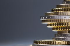 Euro coins stacked on each other in different positions. Close-up european money and currency. Tower background white business pile financial finance wealth stock photo
