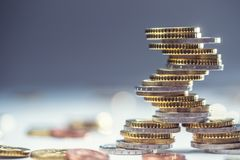 Euro coins stacked on each other in different positions. Close-up european money and currency. Tower background white business pile financial finance wealth royalty free stock photography