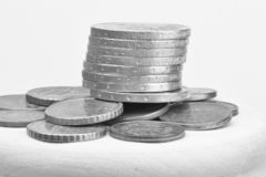 Euro coins stacked on each other in different positions. Selective focus Black and white image royalty free stock photo