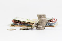 2 euro coins stacked and euro banknotes stock image