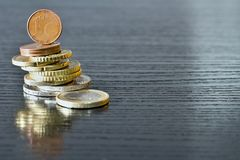 Euro coins are stacked on themselves. A column of euro coins on a luxury table Stock Images