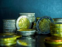 Euro coins on the table. Coin stack with rising chart line, being spotted with scope Stack Euro coins - money stock photos