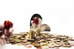 Euro coins on table. Euro coins on table with some decorative mirrors Royalty Free Stock Photography