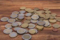 Euro coins on the table. On the table royalty free stock photo