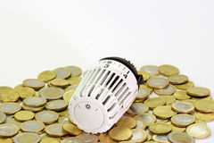 Euro Coins and Thermostat. Thermostat with euro coins in the background Stock Image