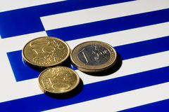 Euro coins on top of the Greek  flag. A few Euro coins on top of the Greek flag Stock Image