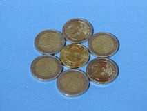 Euro coins. Vatican coin surrounded by EUR coins Stock Image