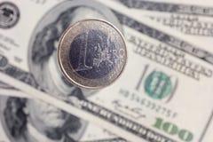 Euro coinsover dollar notes Royalty Free Stock Photos