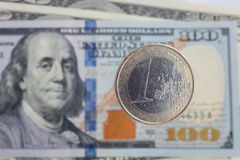 Euro coinsover dollar notes Royalty Free Stock Images